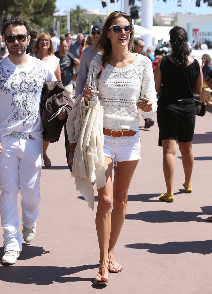Alessandra created a cute pairing with white denim [BLANKNYC] cutoffs and an off-white Candela sweater while vacationing in Cannes.