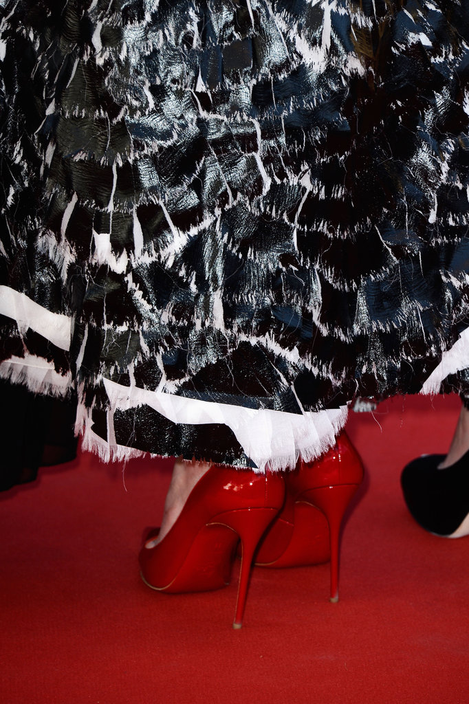 Red patent Christian Louboutins (with their signature soles) added a bright cherry finish to the entire look.