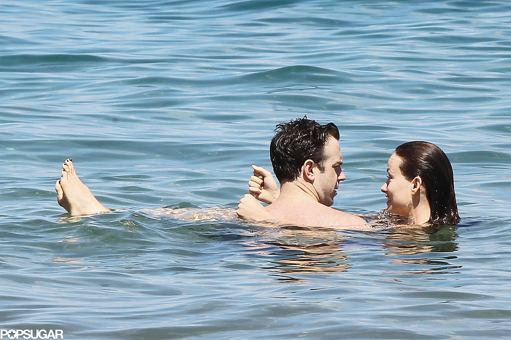 Olivia Wilde and Jason Sudeikis cuddled in the water in Hawaii.