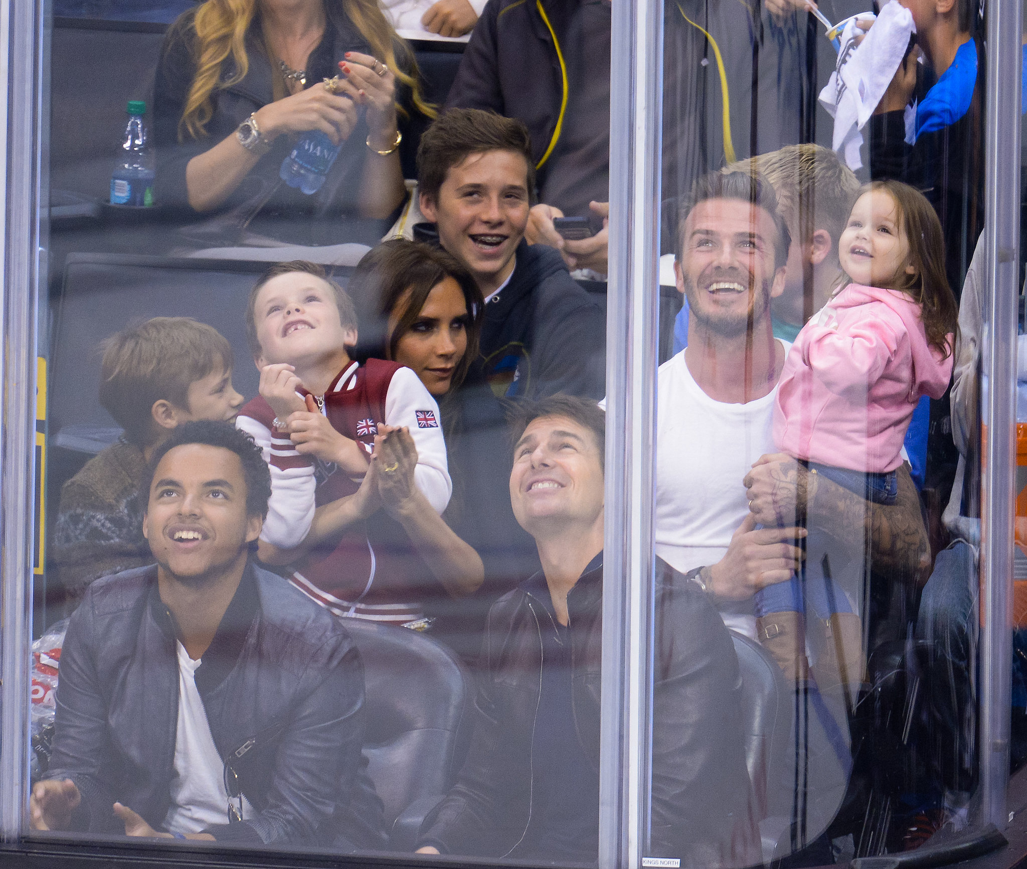 David Beckham and Victoria Beckham and their children sat with Tom Cruise and his son, Conner, at the LA Kings game.
