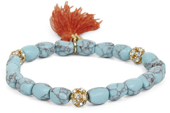 We love that this BCBG Tassel-bead icon bracelet