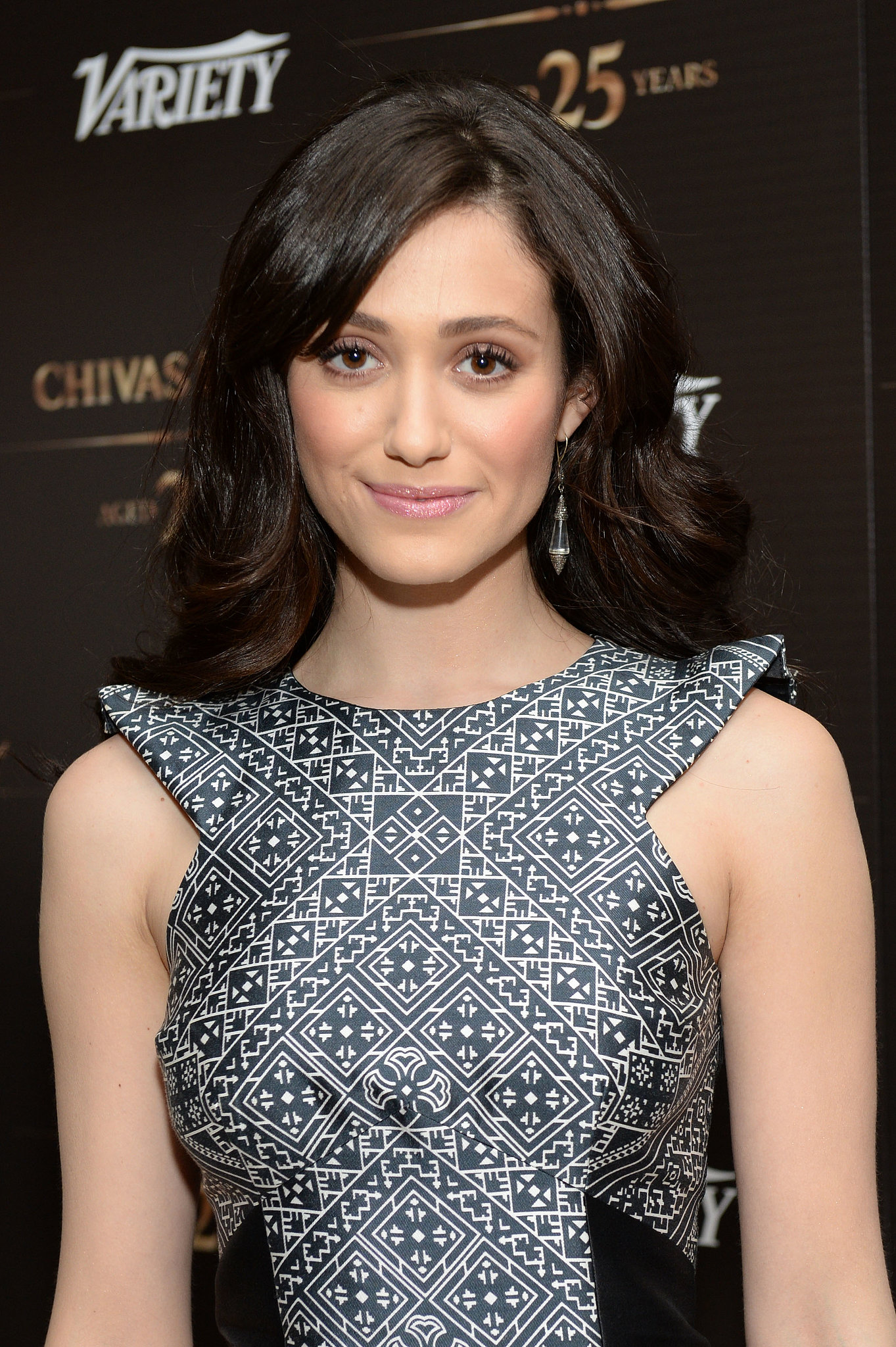 Emmy Rossum's gorgeous pink blush, lengthy lashes, and shiny hair were a standout.