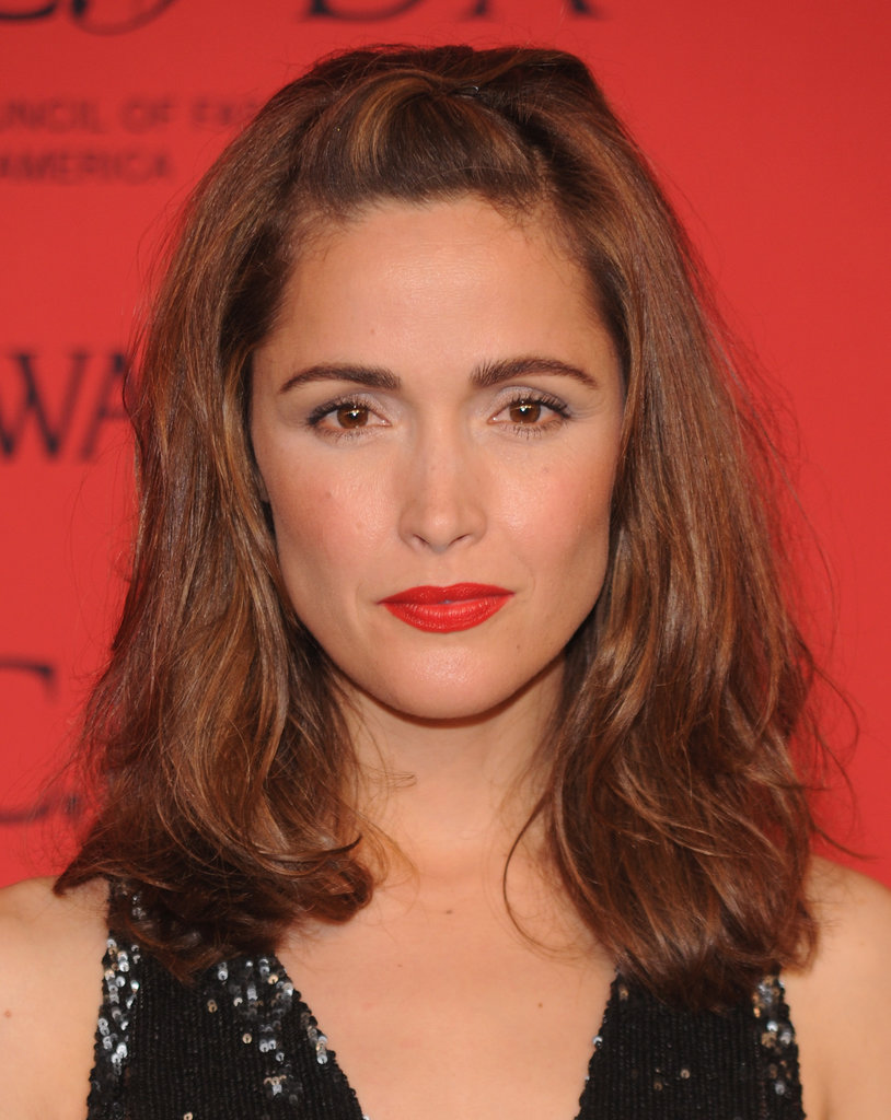 In lieu of her signature bangs, Rose Byrne chose a fringe-free look, allowing her perfectly groomed brows and bright red lips to take center stage.