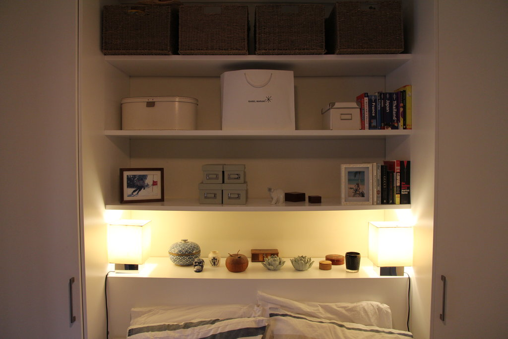 The space above the bed has a nifty built-in shelving system that I use to store my bits and pieces. Lesser-worn jewellery go in the assorted trinket boxes that I've collection from my travels, fascinators in the IKEA hatbox and chunky scarves in the Isabel Marant carry bag from Paris that I just couldn't bear to bin.
