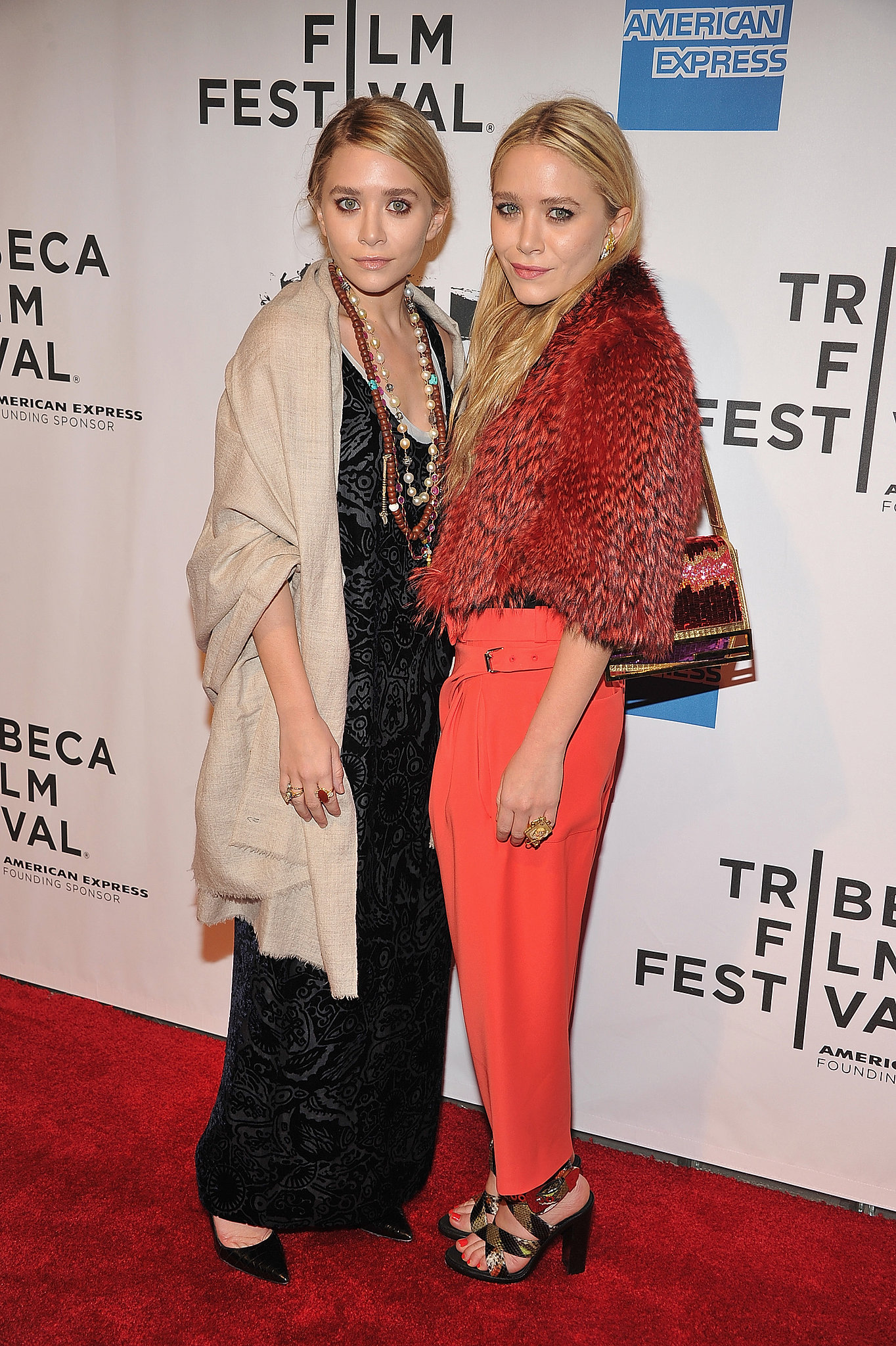 Twinning combo: Proving their expertise in mixing eclectic prints with textures, Mary-Kate and Ashley turned heads at the 2011 Tribeca Film Festival.  Ashley shrugged a burlap-hued shawl over her black-and-silver brocade maxi, then tossed on an array of boho-chic necklaces and rings. Mary-Kate's love of fur extended with a cropped orange-and-red creation, coordinating trousers, and python sandals.