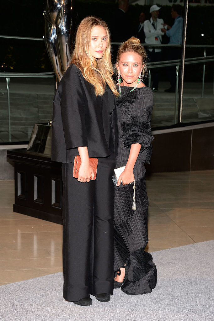 The Olsen sisters (and no, not the twins) turned up in similar black-on-black ensembles. Younger sister Elizabeth opted for a minimal trouser suit and Mary-Kate worked a textural maxi dress by Issey Miyake.