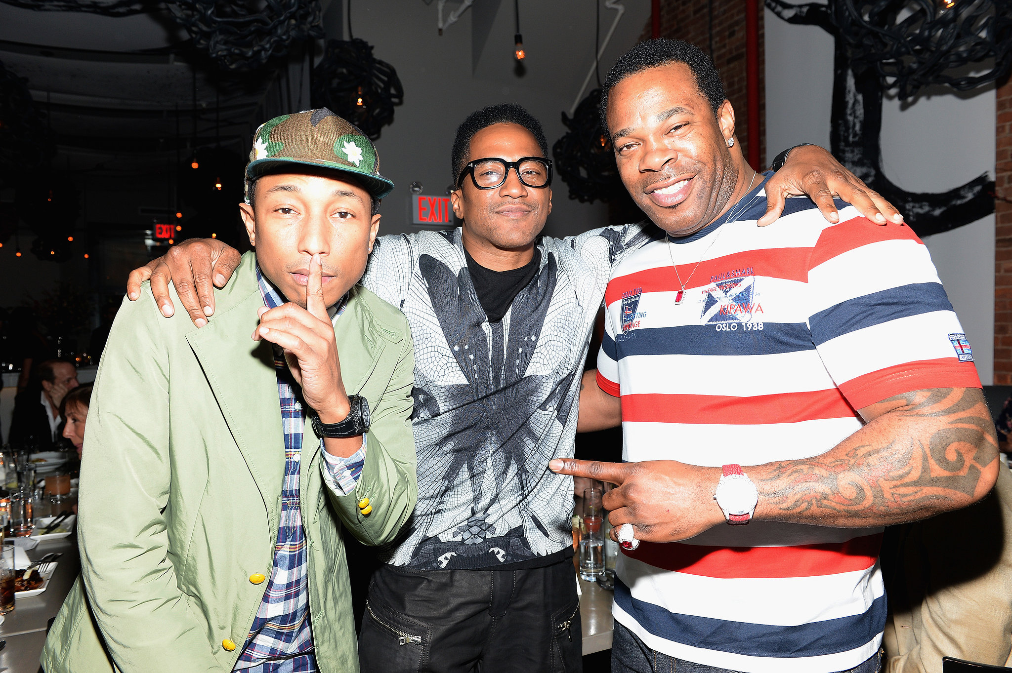 Pharrell Williams mingled with Q-Tip and Busta Ryhmes inside the dinner party.