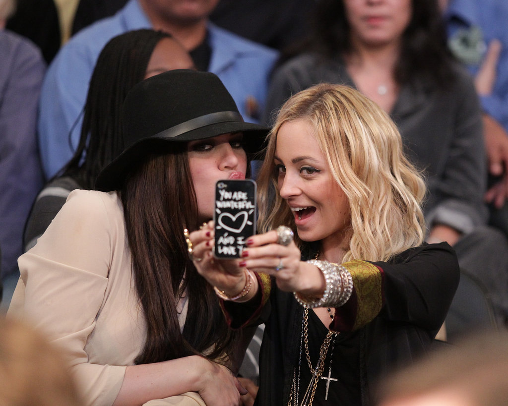 Khloé Kardashian and Nicole Richie took a break from watching a January 2011 Lakers game to pose for a picture courtside.