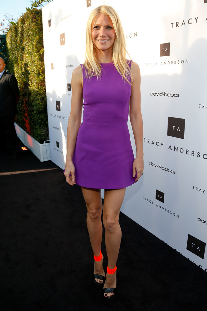 Gwyneth Paltrow's purple Victoria Beckham minidress found a sassy companion in a pair of Michael Kors neon orange and black ankle-strap sandals at the Tracy Anderson Method opening in Brentwood.