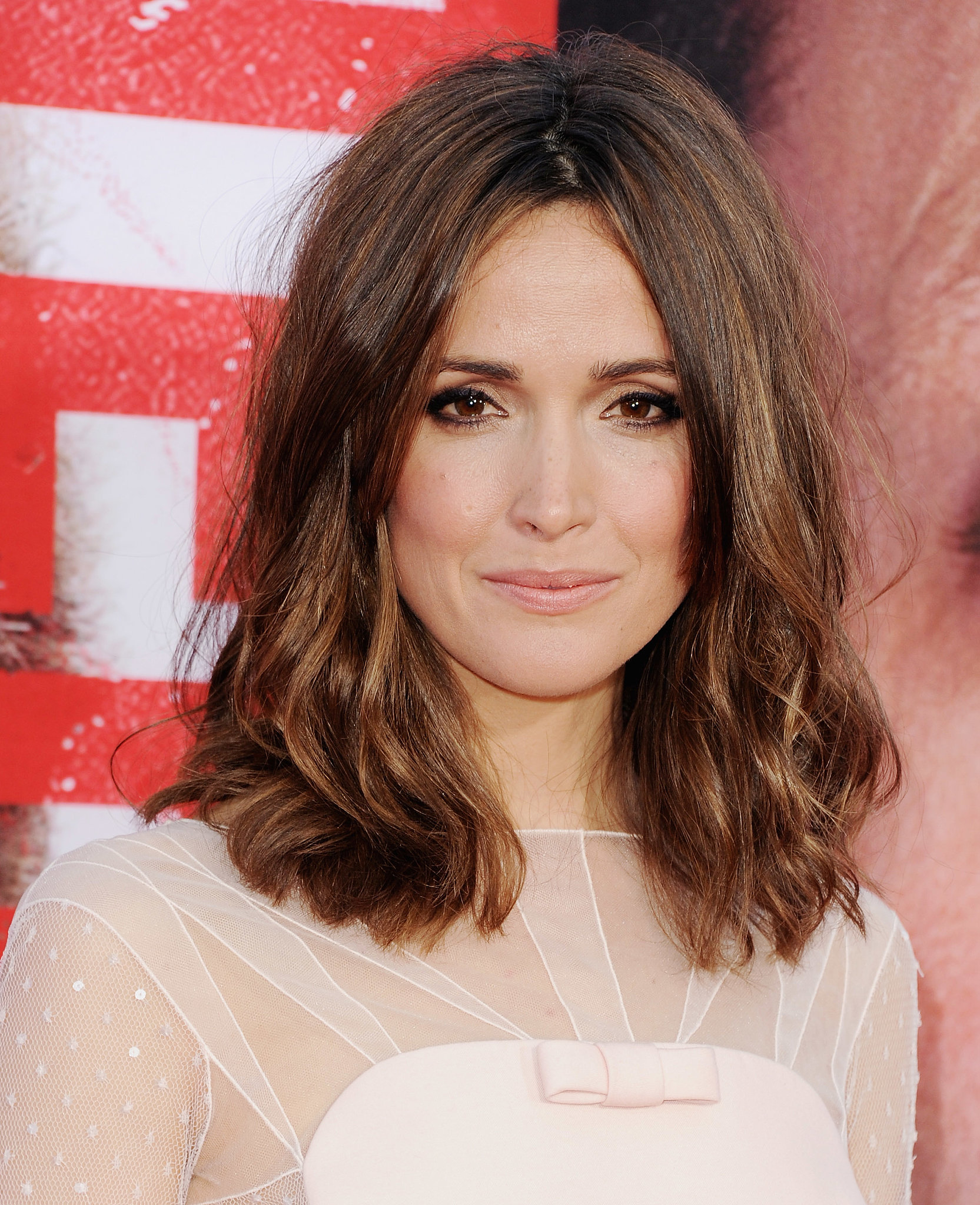 Rose Byrne's textured waves added a subtle edge to her feminine dress.