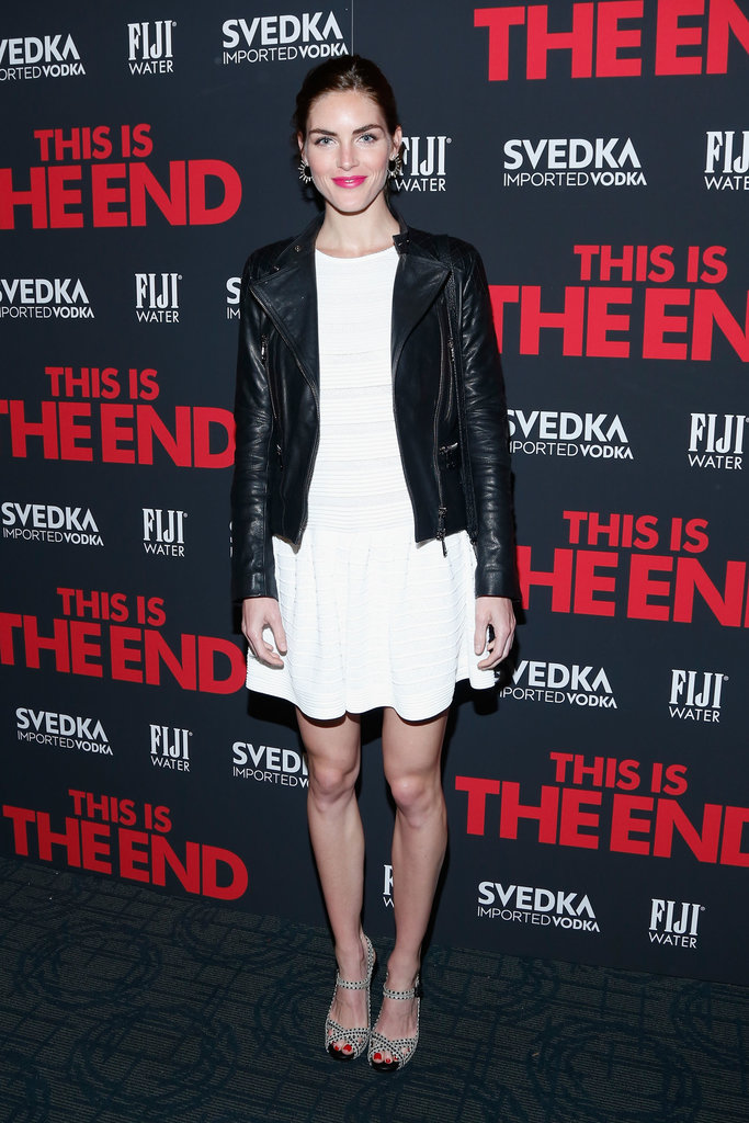 Hilary Rhoda toughened up her little white dress with a black leather jacket and printed sandals at the This is the End premiere in NYC.