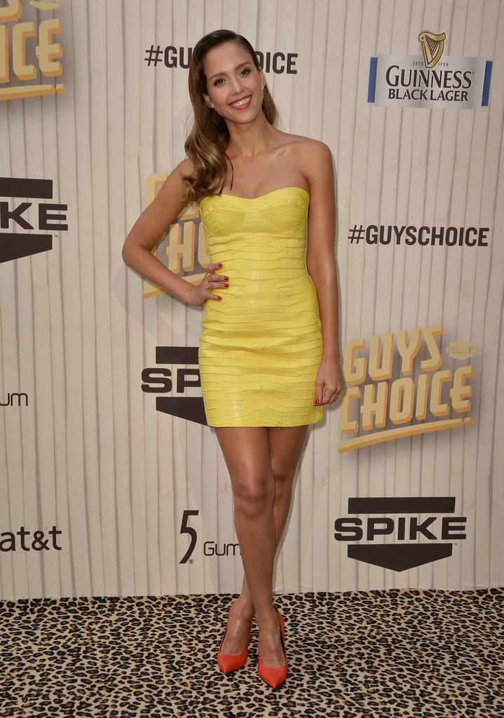 Jessica Alba's bright yellow Versace minidress and bold orange pumps lit up the leopard-print carpet at the Guys Choice Awards in LA.