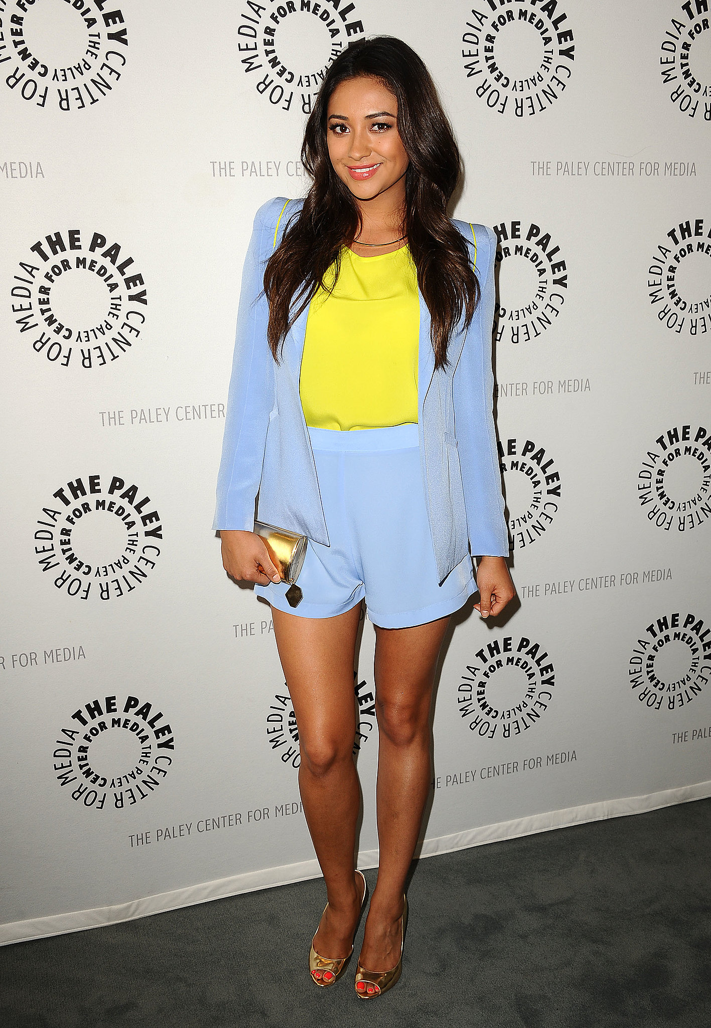 Shay Mitchell creates a fun Summer color duo with a baby blue shorts suit and a neon yellow tank at a Paley Center for Media event in LA.