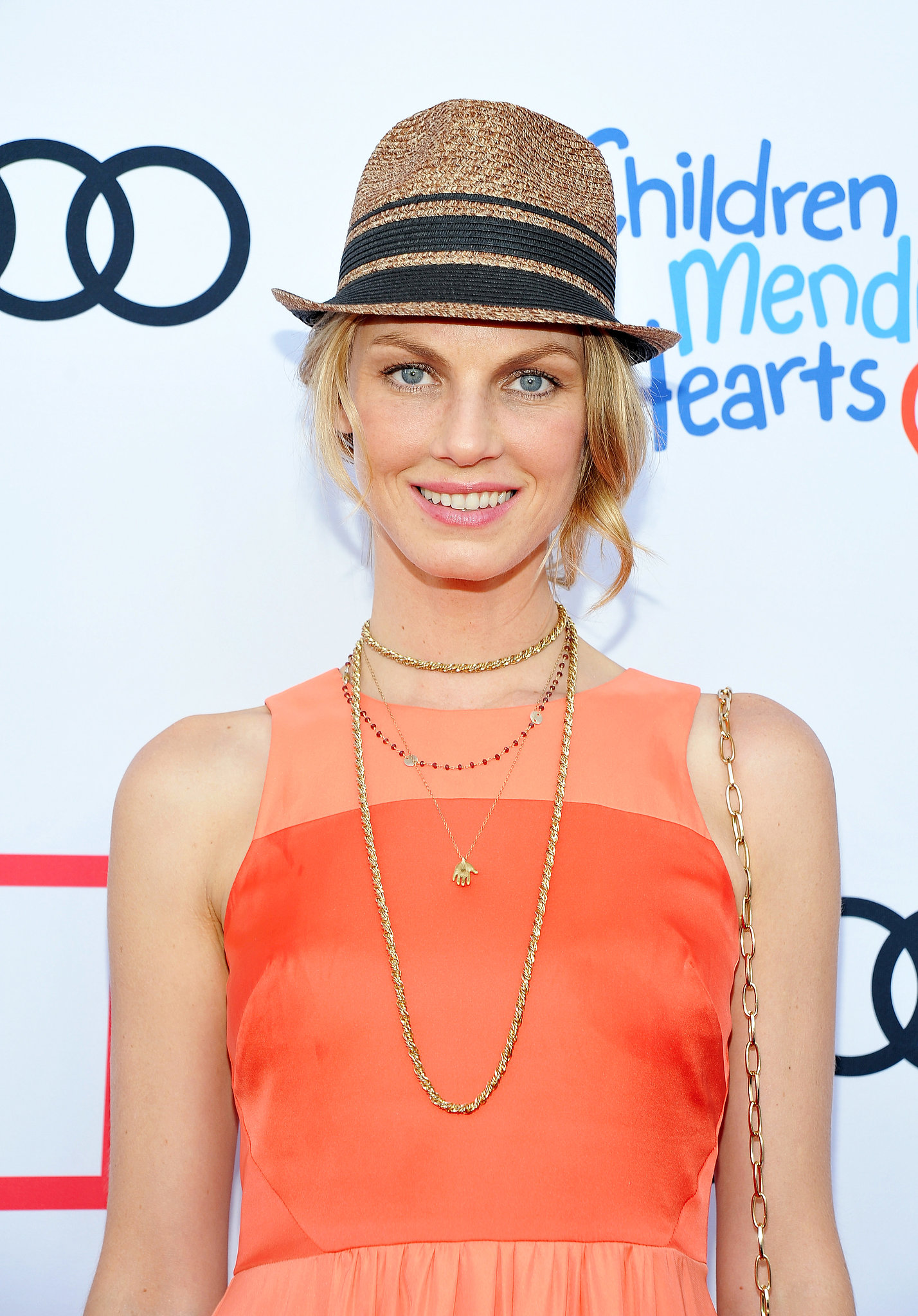 Model Angela Lindvall topped off a low bun with a Summer hat — an easy way to disguise a not-so-stellar hair day.