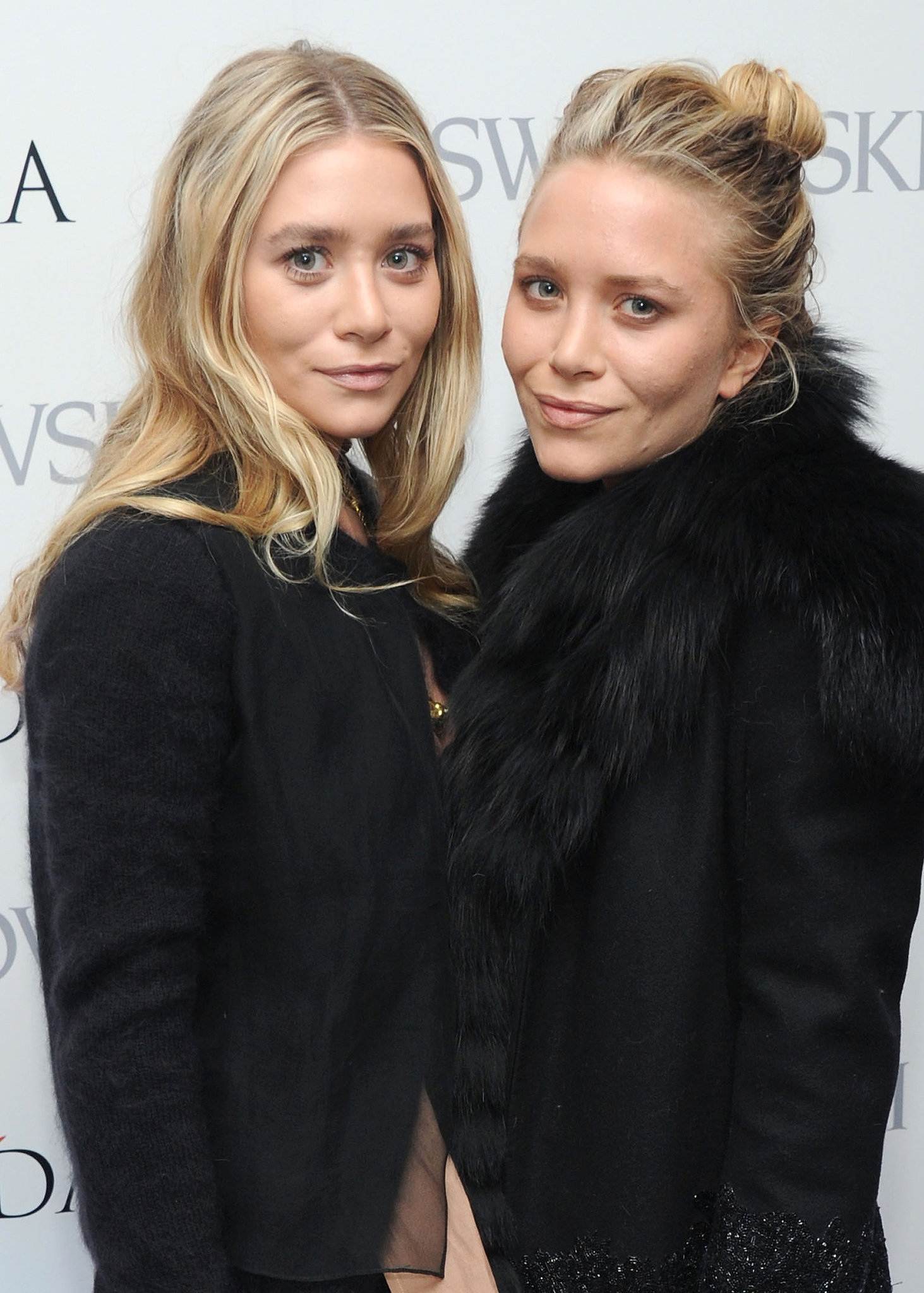 At the 2013 CFDA Award nominations, Ashley and Mary-Kate both had light blond hair, which they paired with a nude makeup palette. Ashley wore her hair down in waves, while Mary-Kate opted for a chic topknot.