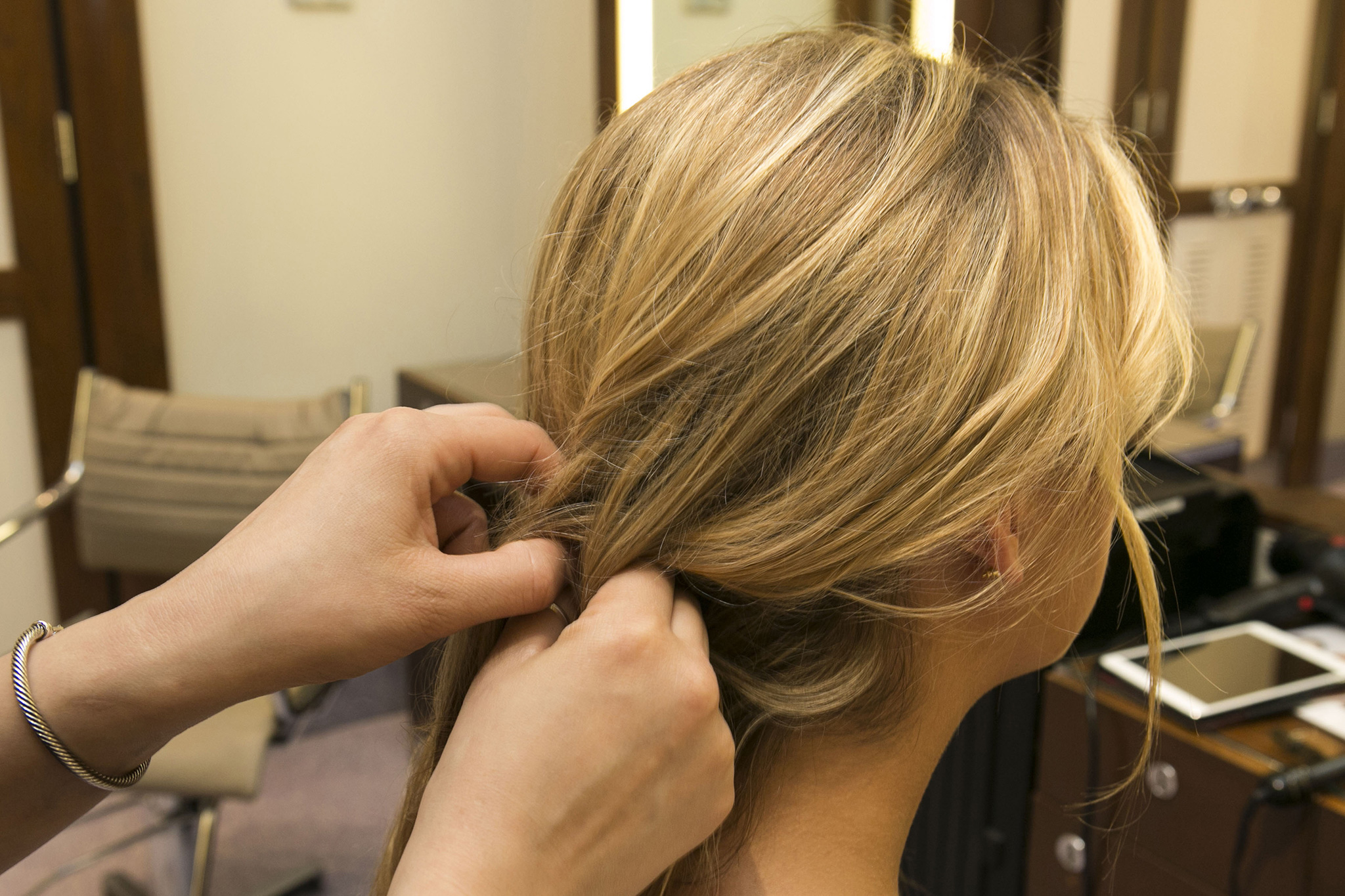 Next, the advanced DIY braider can create a loose french braid starting behind the opposing ear to help hold the sideswept hair in place. For beginners, try a regular braid or just twist hair over to help keep it in place.