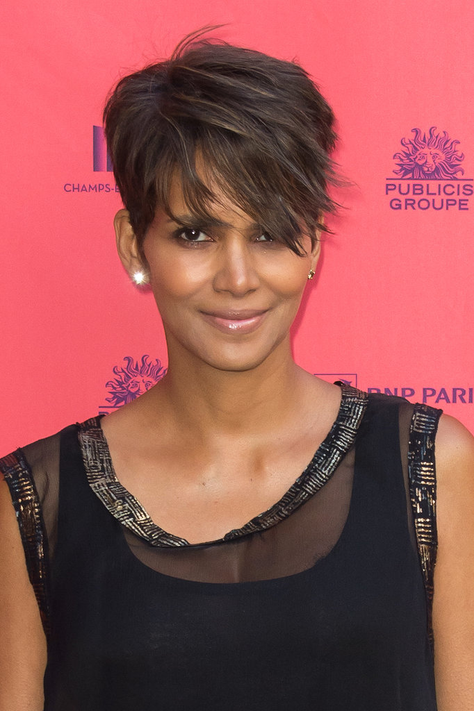 A pregnant Halle Berry was out in Paris with a wispy hairstyle and natural-looking makeup.