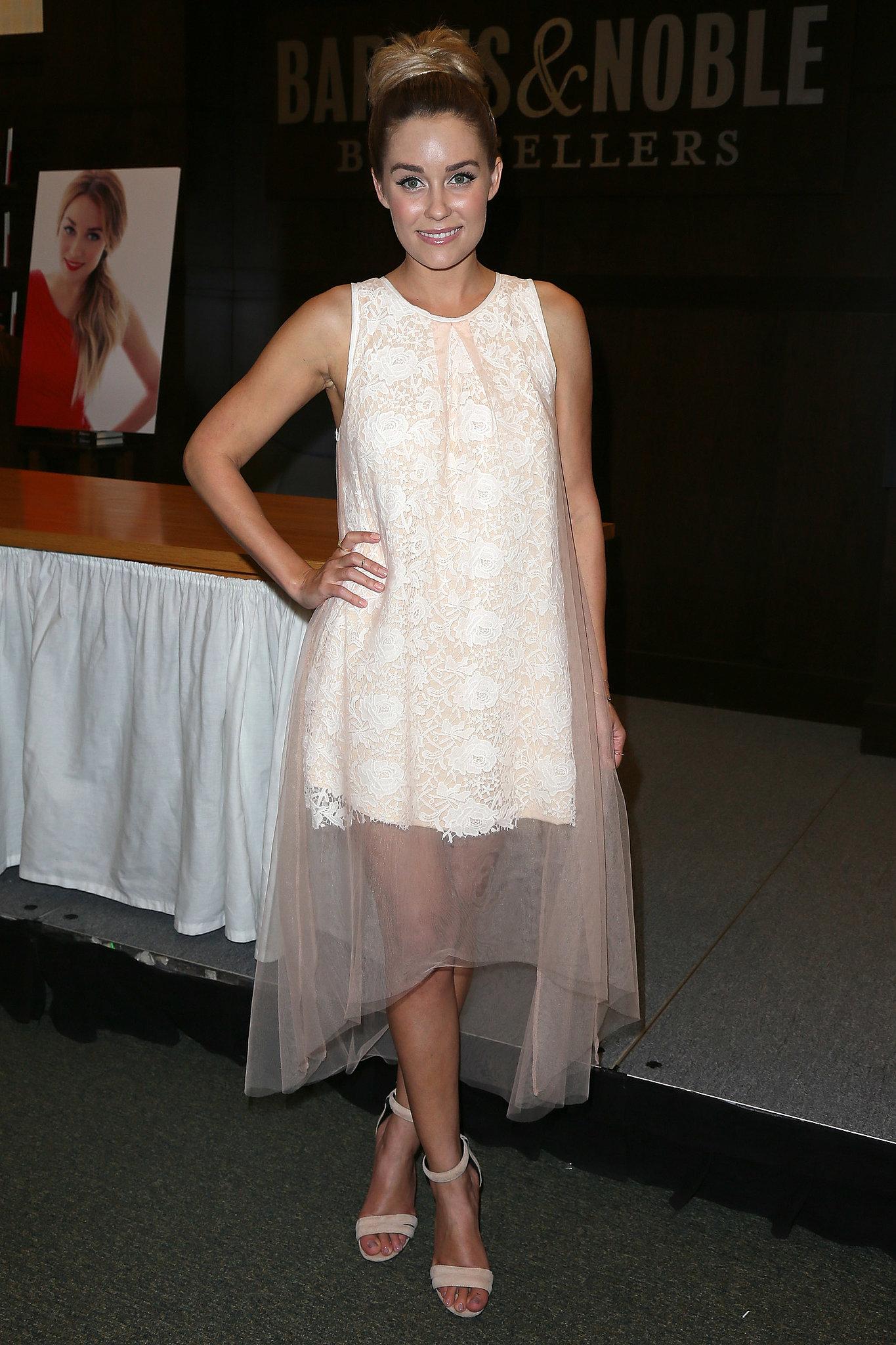 Lauren Conrad showed off a dreamy Summer dress at a book signing in LA.