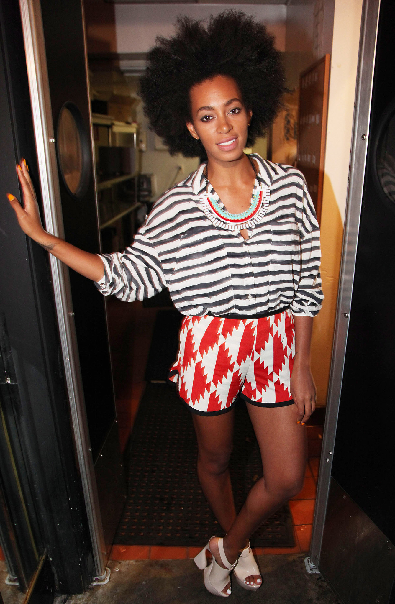 Knowles was perfectly mix-matched in a striped blouse, geometric-print shorts, white platforms, and a stunning bib necklace during a May 2011 trip to NYC.