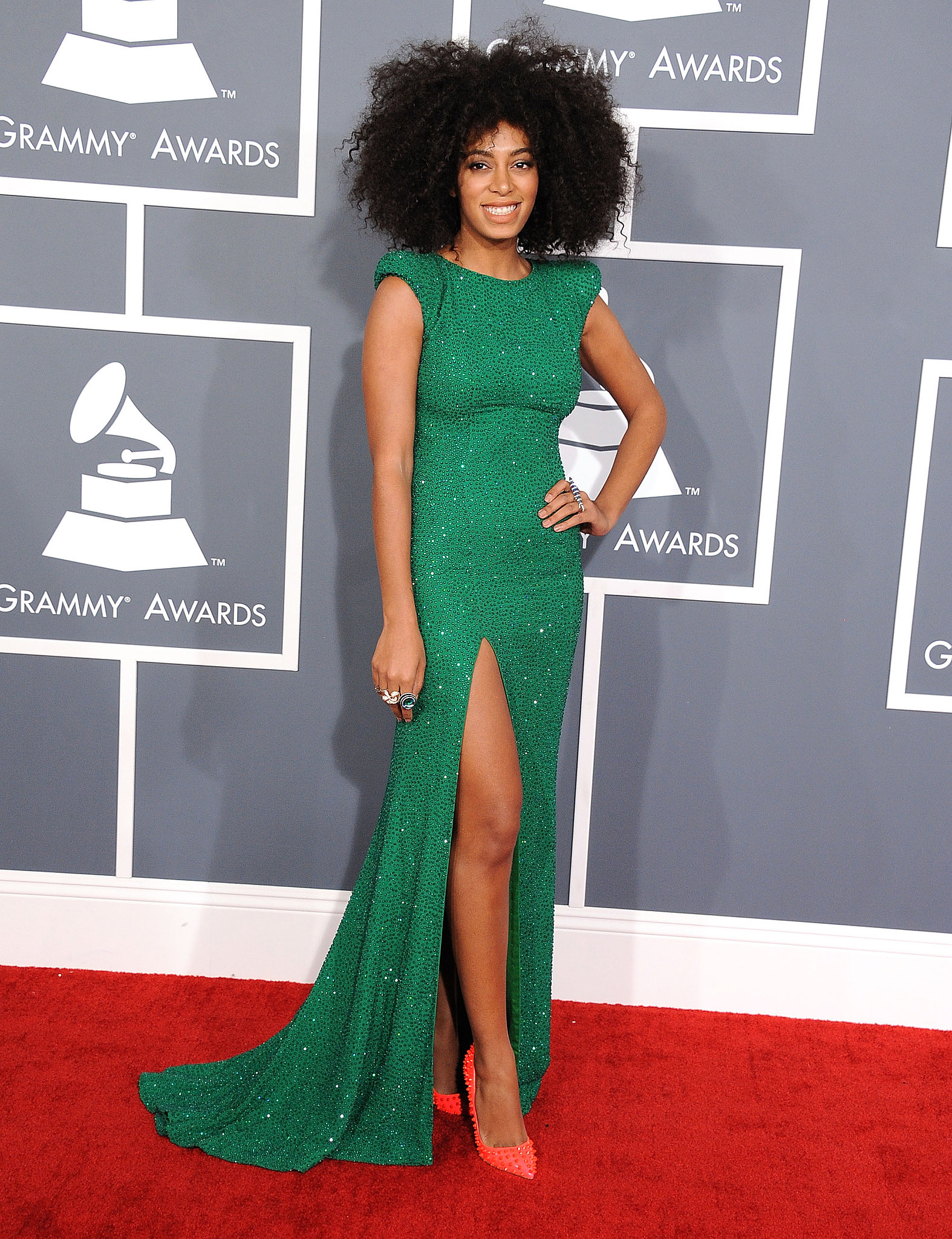 Solange hit the 2012 Grammy Awards red carpet in a shimmering emerald Ralph & Russo Couture gown and neon studded pumps.