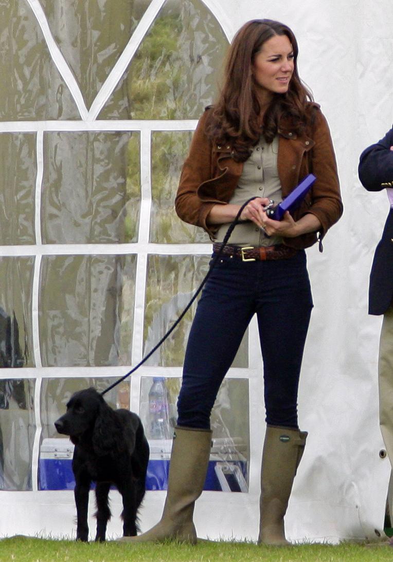 kate middleton kept her dog lupo on a leash at the june. Black Bedroom Furniture Sets. Home Design Ideas