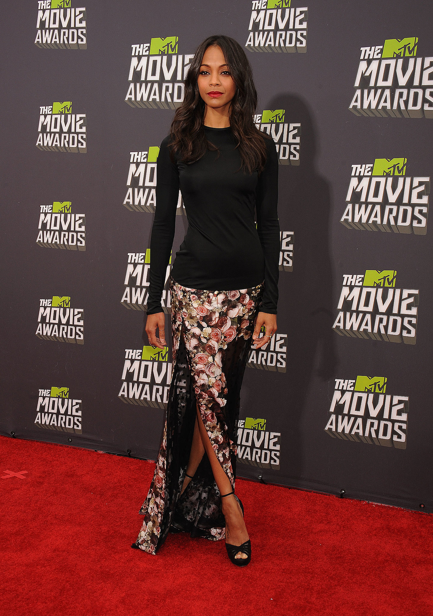 Zoe took the red carpet at the 2013 MTV Movie Awards in this cool-girl play on eventwear from the Givenchy Fall 2013 collection.