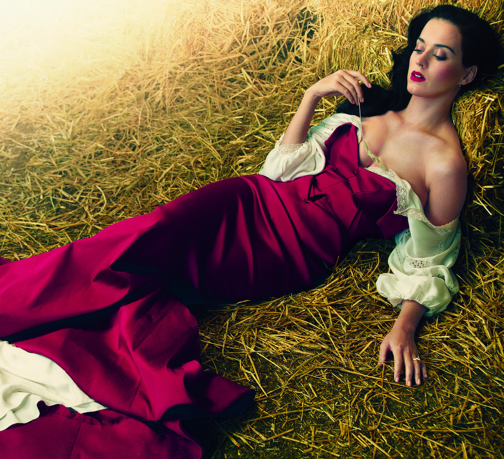 Katy Perry poses on hay for US Vogue. Source: Annie Leibovitz/Vogue