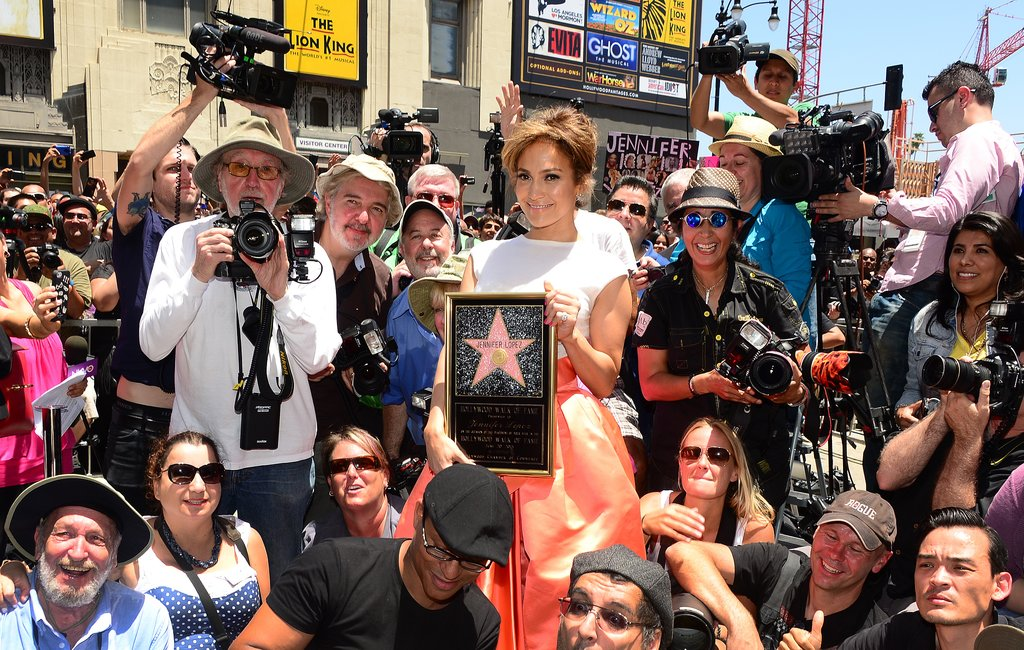 Jennifer Lopez smiled in a crowd after receiving her award.