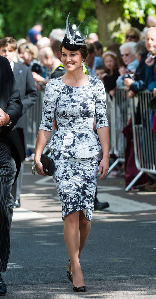 For a June wedding, Pippa picked a black and white pairing, arriving in a matching skirt and peplum top.