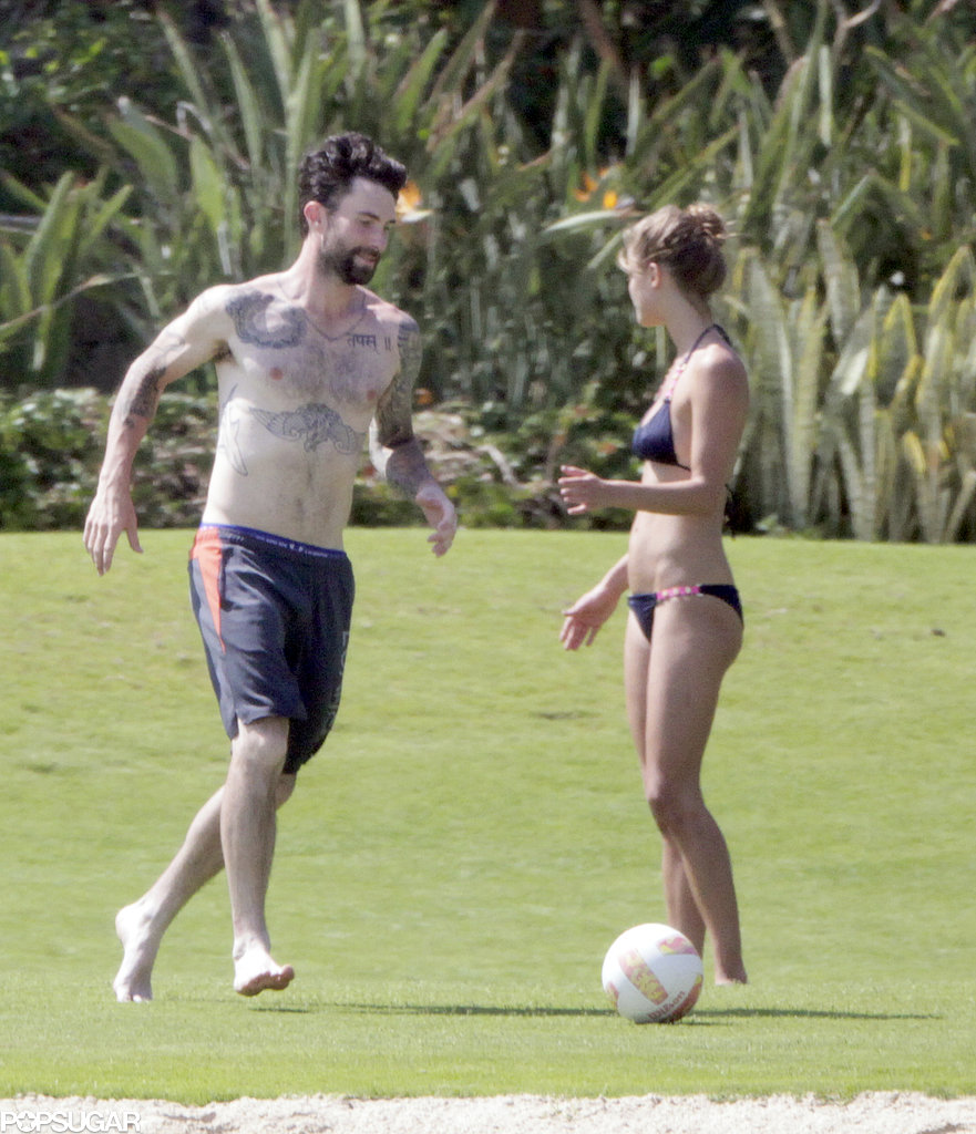 Adam Levine and Nina Agdal showed skin during their game.