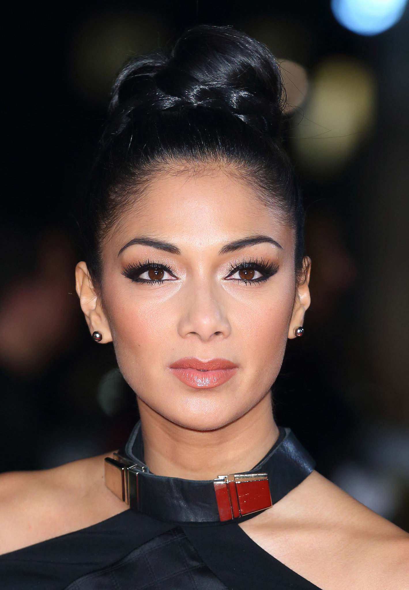 Just like you often see hair wrapped around the elastic of a ponytail, you can create a similar style with a topknot. Nicole Scherzinger accented hers with a braid.