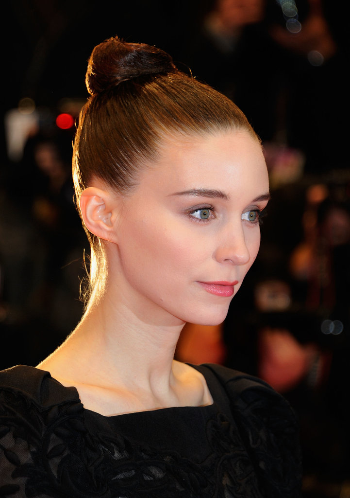You'll need a good amount of gel or pomade to get your hair to stay put à la Rooney Mara. She has no flyaways in sight.