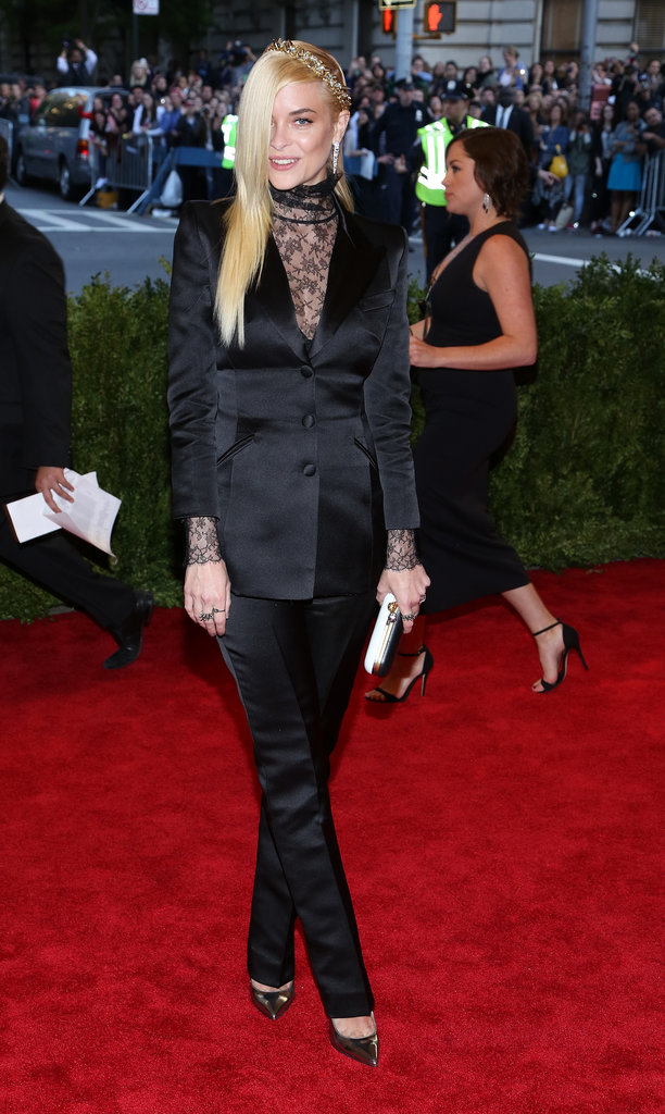At the 2013 Met Gala in NYC, Jaime kept her bump classy in a black satin Topshop suit. We love that she showed just enough skin via a sheer black lace blouse. Do the same for your next nighttime affair.