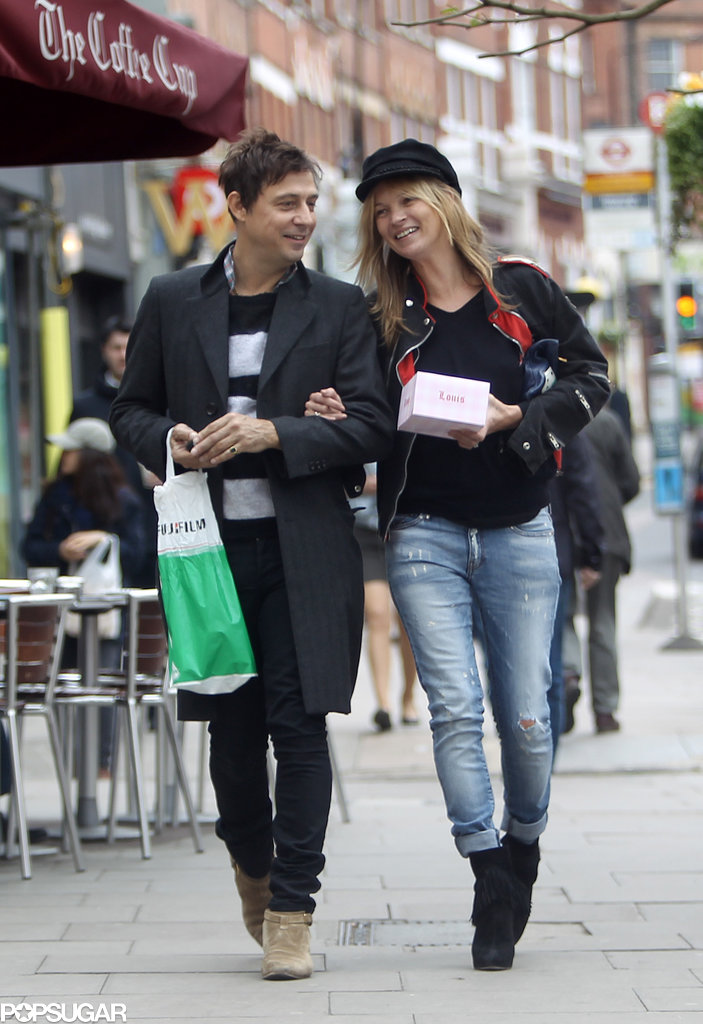 The couple laughed together after stopping at a candy store in London in May 2013.