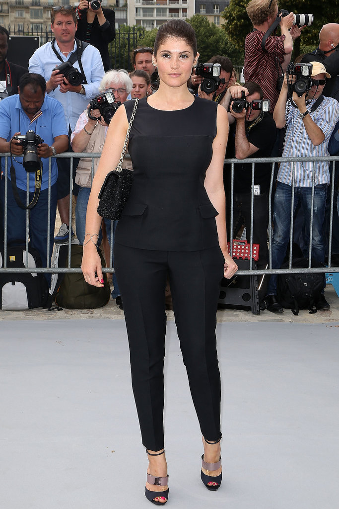 Gemma Arterton was sleek in a black top and cropped pants, a chain-handle bag, and strappy sandals, all by Dior.