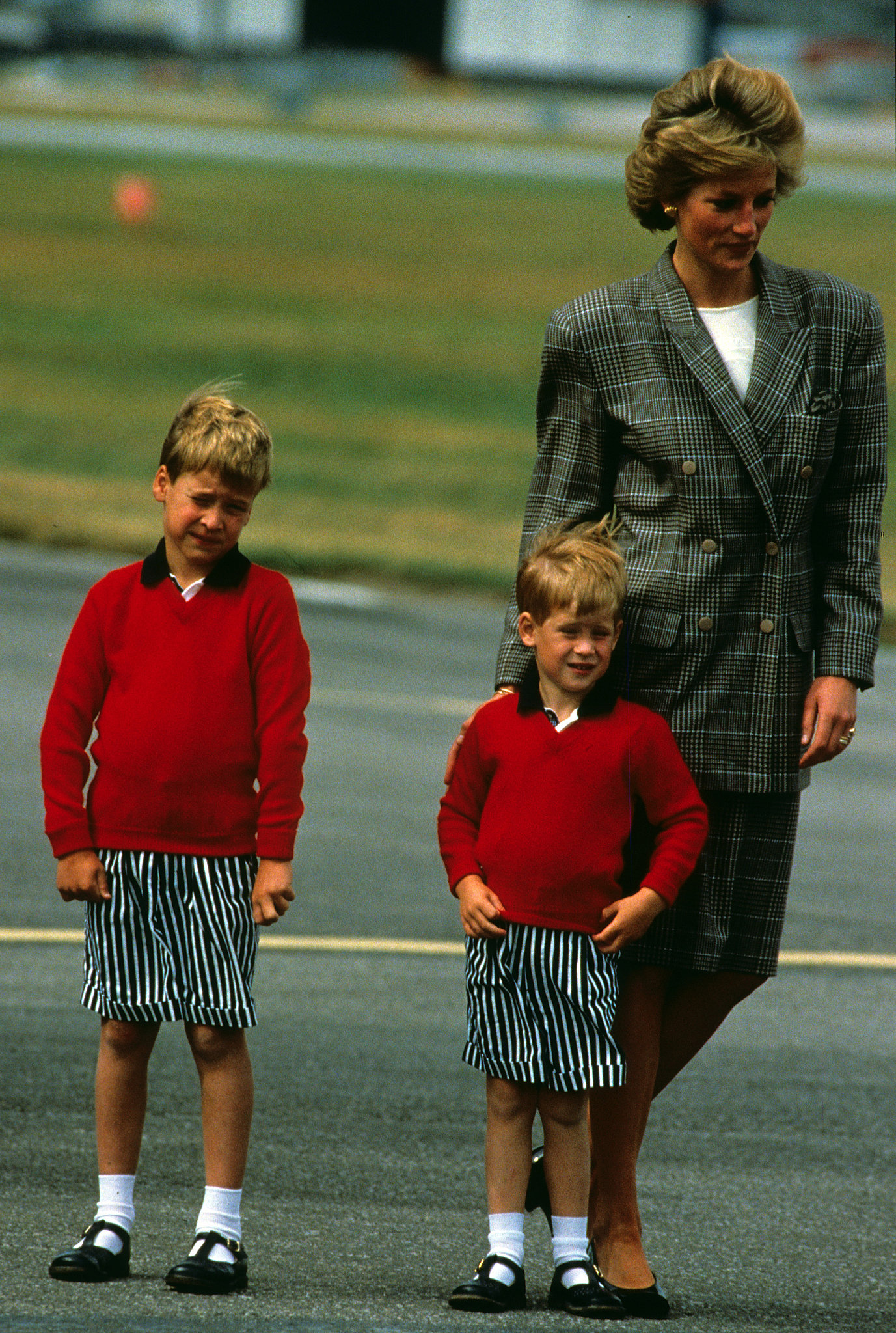 Princess Diana walked with a matching Prince Harry and Prince William while heading to Scotland in August 1989.