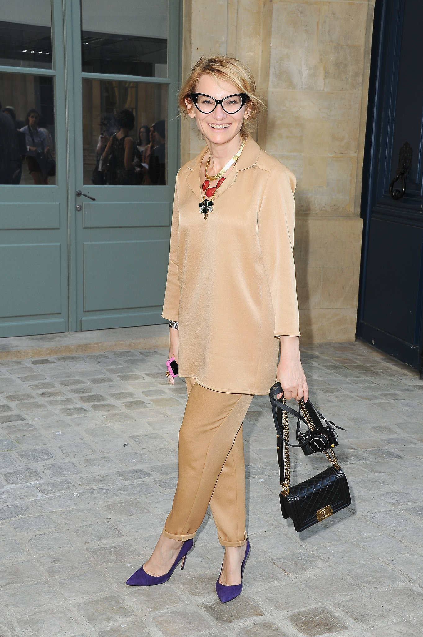An elegant all-beige look at the Alexis Mabille show let statement accessories take center stage —chiefly a pair of cat-eye specs.