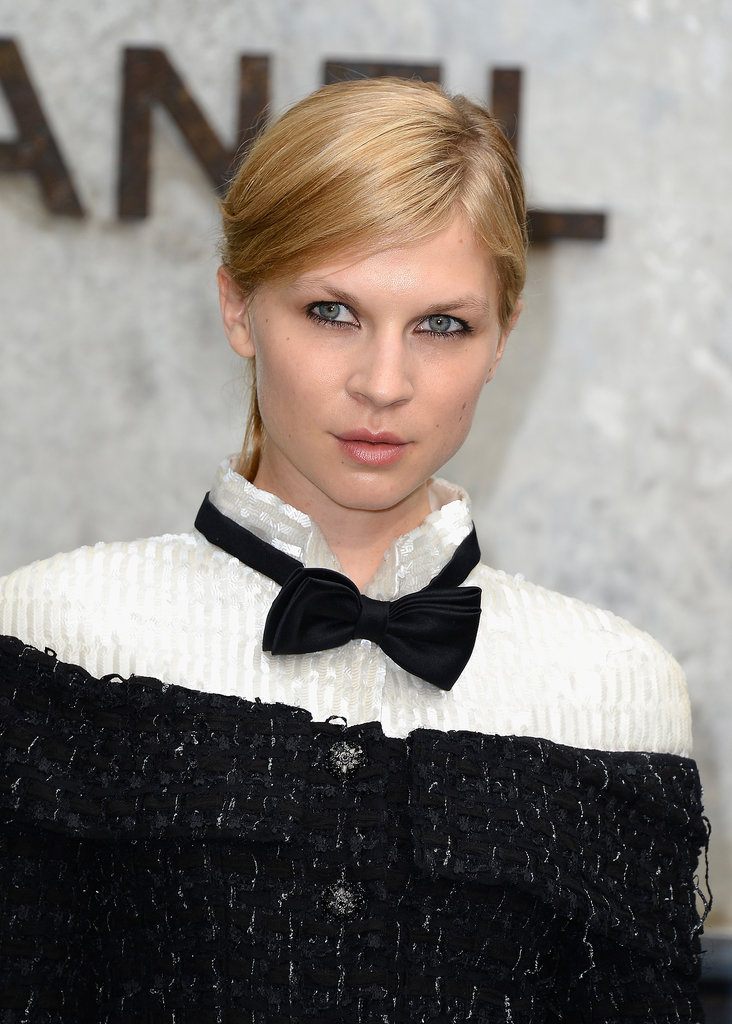 Going for a more dramatic look, Clémence Poésy swept her hair back to bring focus to her tightly lined lids and the black and white neckline of her Chanel dress.
