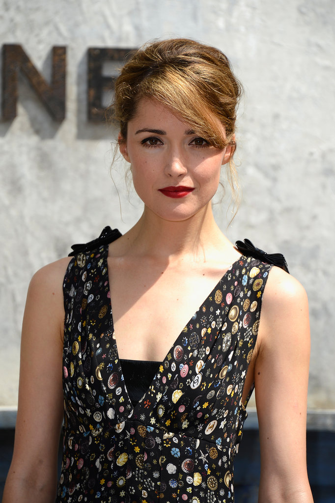 With a voluminous updo and bold red lip, Rose Byrne brought plenty of glam to Chanel's star-studded front row.