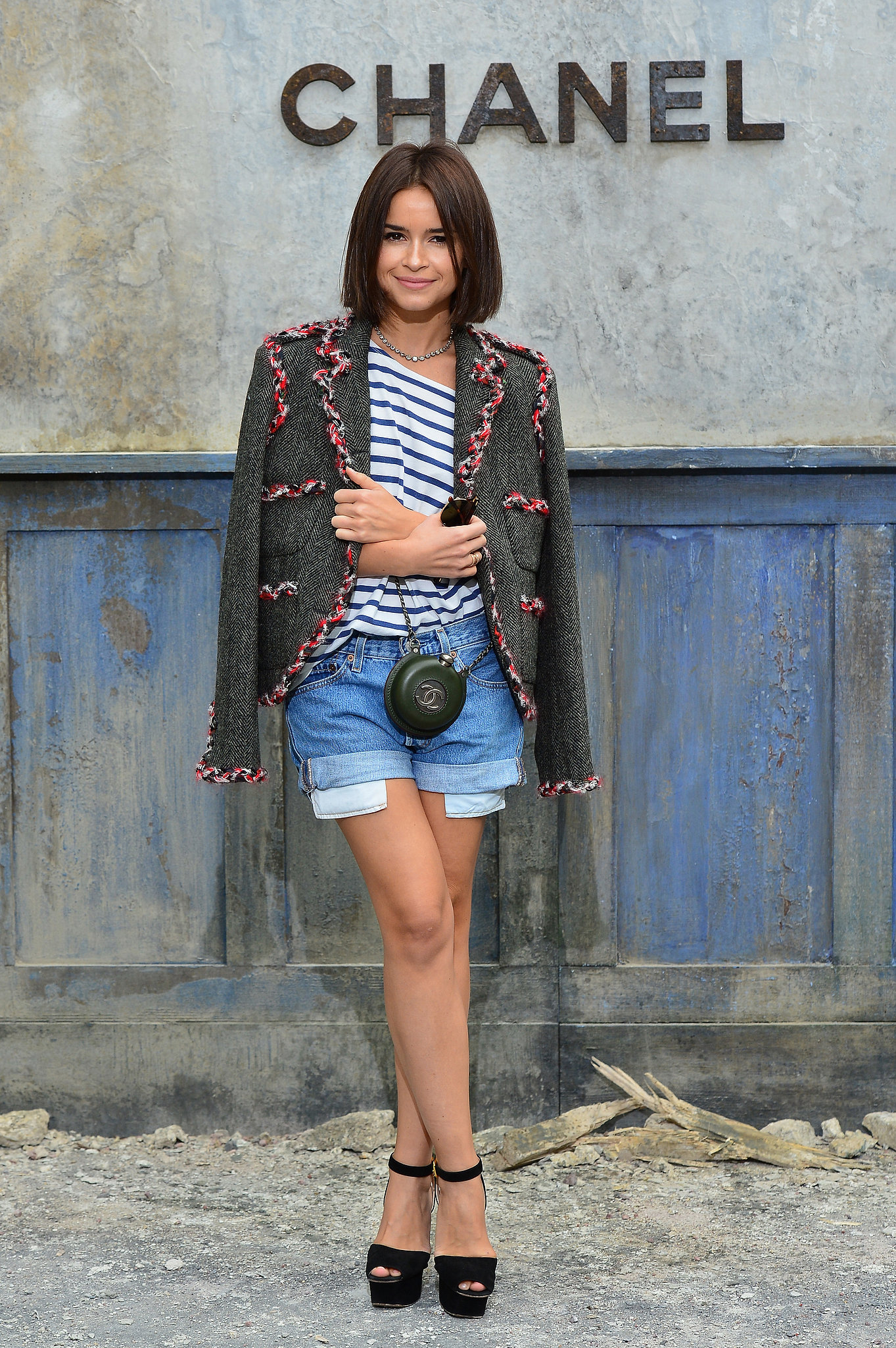 Also at Chanel? Miroslava Duma, who topped cutoffs and a striped tee with a luxe blazer.