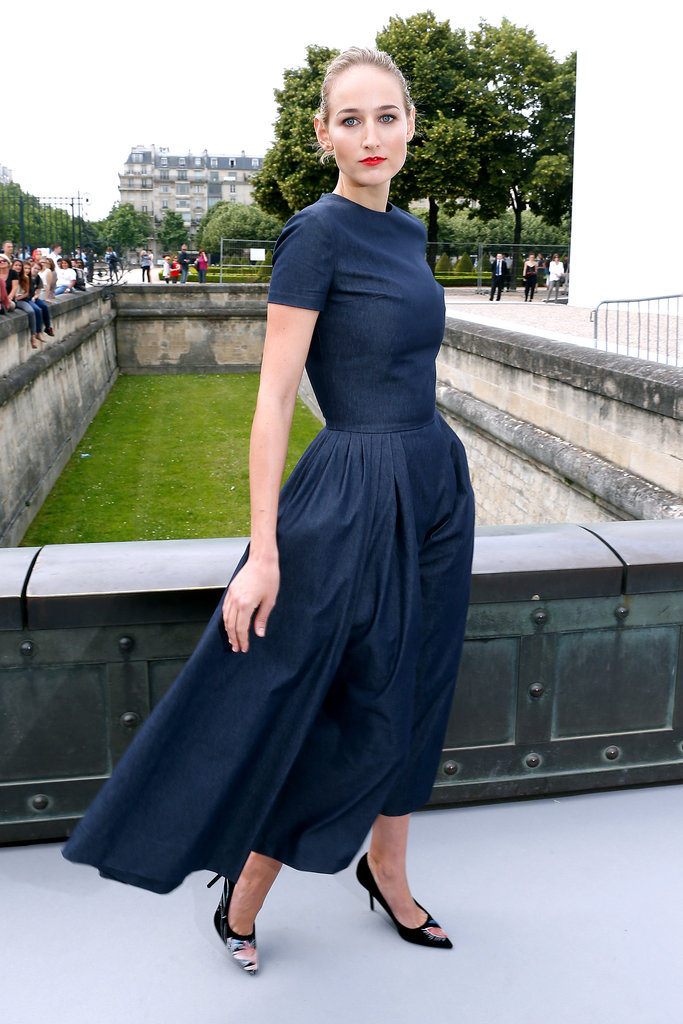 Outside the Dior show, Leelee Sobieski posed in a simple navy number with a dramatic silhouette and painted pumps by the house.