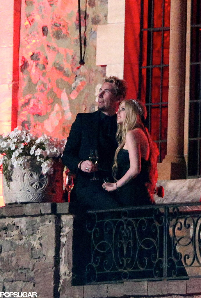 Avril Lavigne and Chad Kroeger toasted on the balcony.