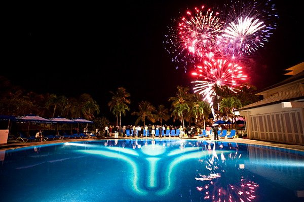 These wedding fireworks made a stunning show over the pool. Source: Style Me Pretty
