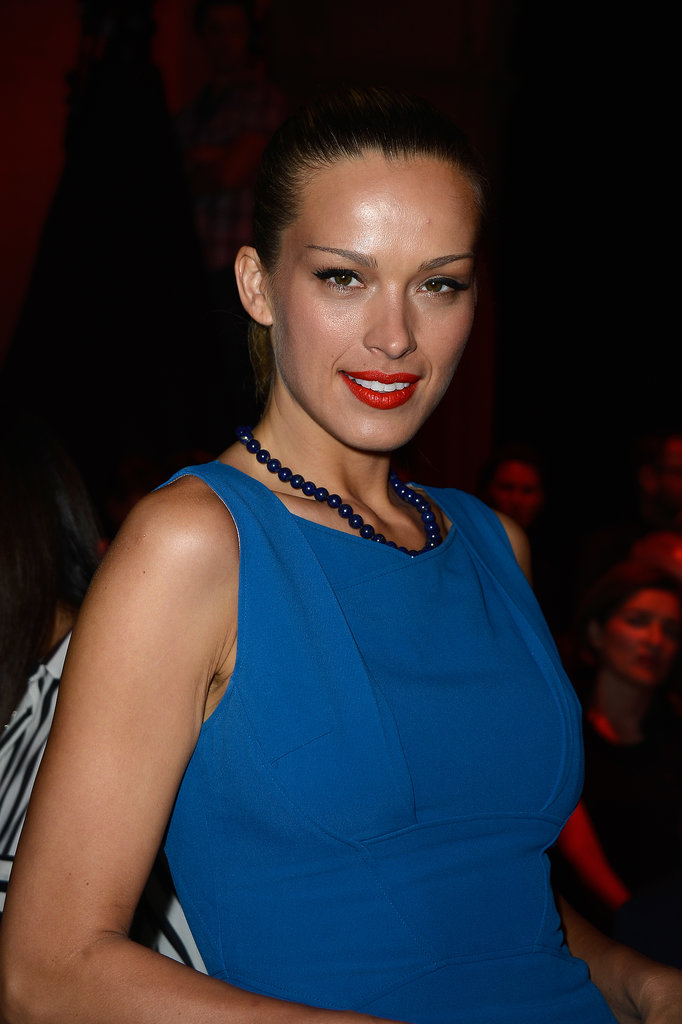 Seen in the front row at Elie Saab, Petra Nemcova paired her bright blue dress with an equally bold ruby lip color.