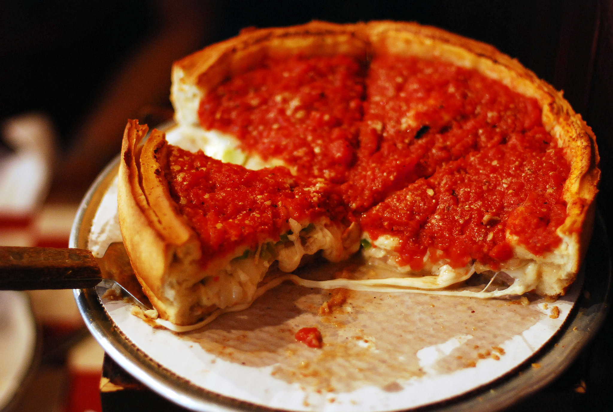 One simply cannot live life without trying deep-dish pizza with its ...