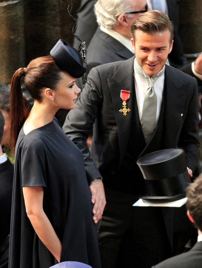 At the royal wedding in Apr. 2011, Victoria was pregnant with daughter Harper, and David affectionately put his hand on his wife's bump before the ceremony.