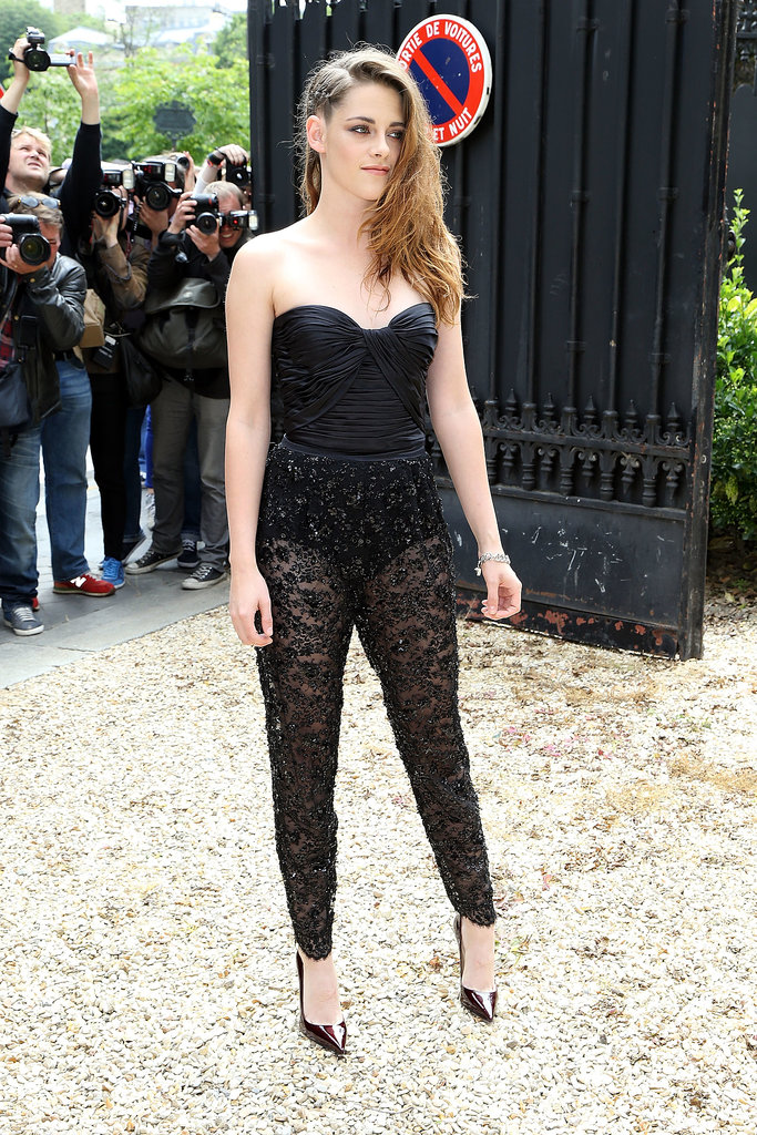 Kristen Stewart amped up the sex appeal when she opted for a lace jumpsuit to attend the Zuhair Murad runway show.
