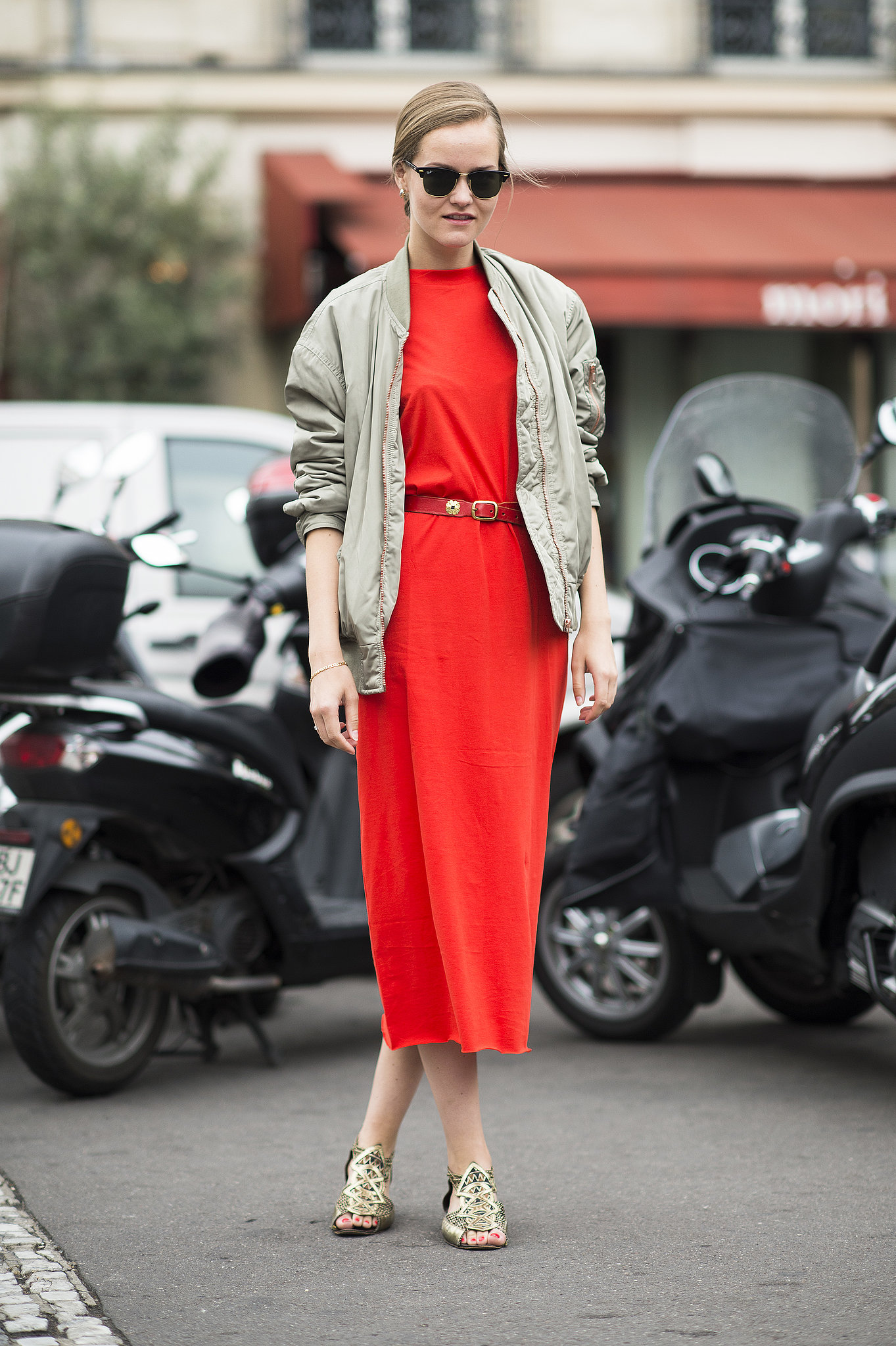 Make sure bold red really stands out by pairing it with soft neutrals, like this red dress accented with beige.