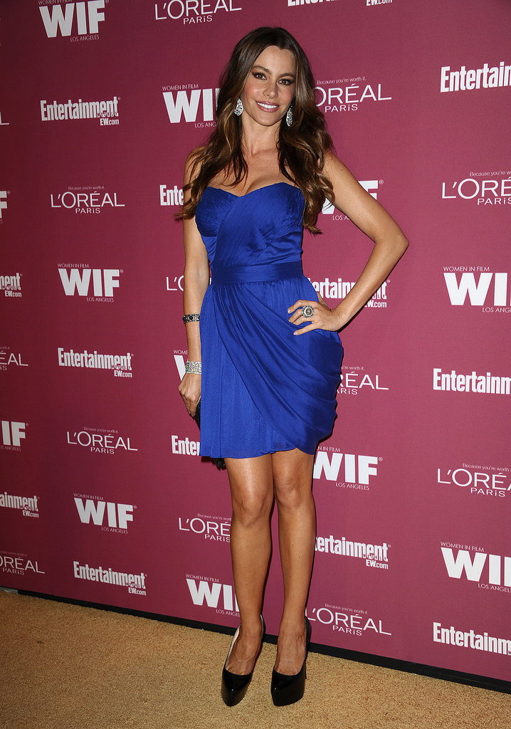 Sofia Vergara married black and blue in a draping cobalt minidress and patent platform pumps at a Pre-Emmy party in West Hollywood.