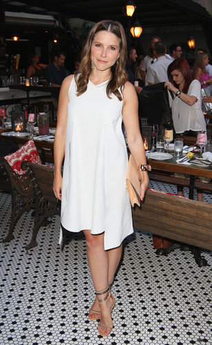 Sophia Bush's birthday party in NYC included food, drinks, and, of course, a fabulous white leather Sportmax dress with nude accessories.